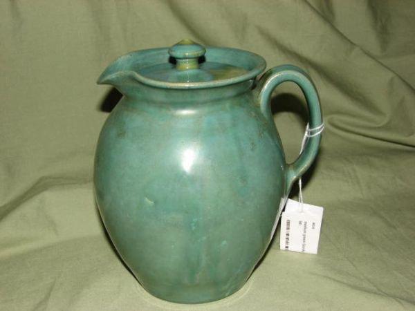 24: W.J. Gordy medium green glaze pitcher w/lid
