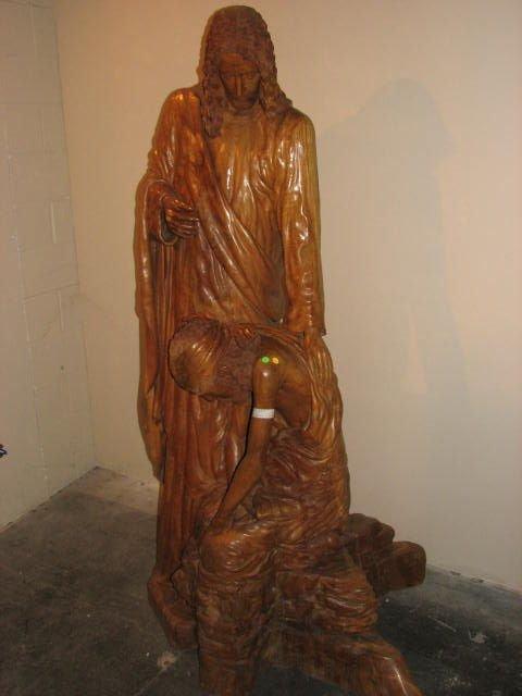 504: Lifesize carved teakwood statue Jesus w/sinner.