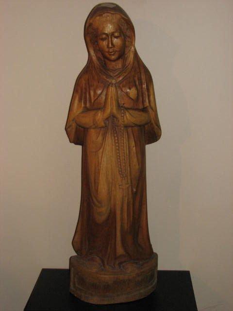 505: Carved teakwood statue of Mary.