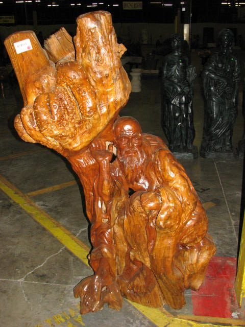 514: Old chinese man carving teakwood stump statue.