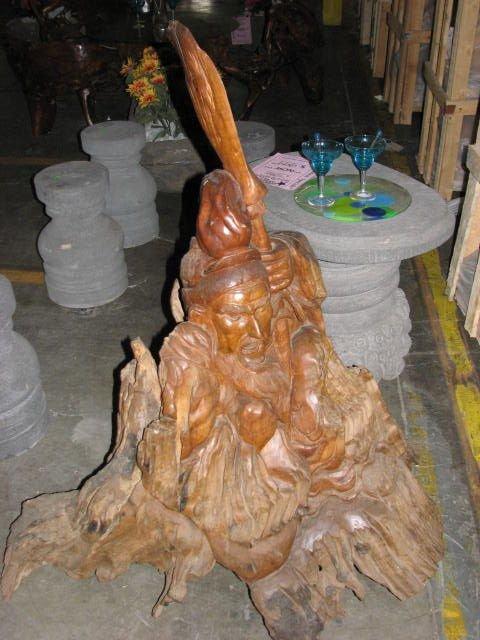 518: Chinese man carved teakwood stump carving.