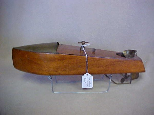 12: Early wood & brass wind up boat.
