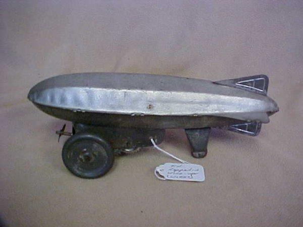 13: Early Tin Zepplin windup toy