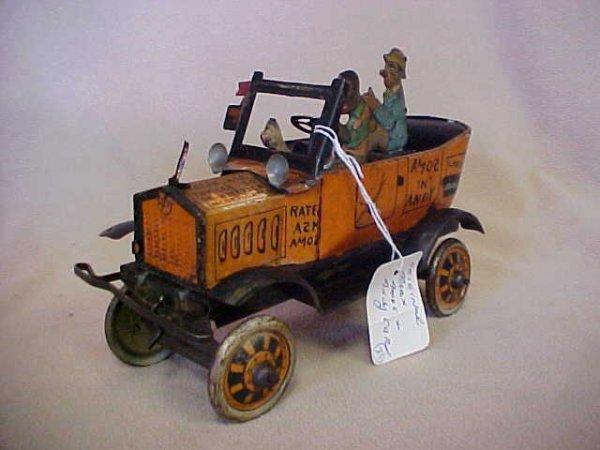 29: Original Marx Amos & Andy tin litho wind up car.