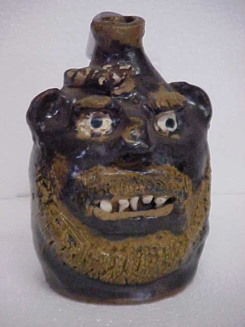 8: Marie Rogers snake face jug