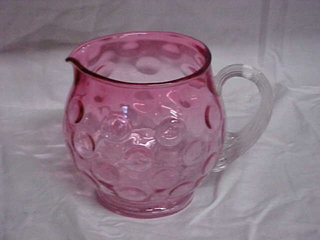 19: Victorian Cranberry pitcher w/clear applied handle.