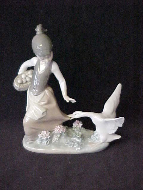 "9: LLadro porcelain figurine girl w/swan 8"" tall x 16'1"