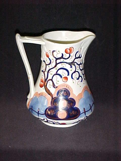 10: 1800's porcelain decorated pitcher w/cobalt blue.