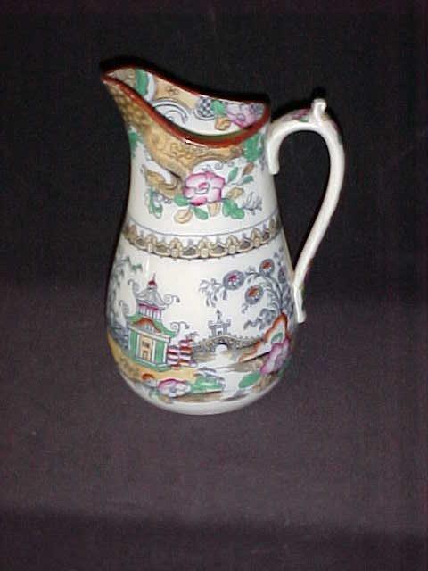 14: 1800's flow blue porcelain oriential decorated pitc