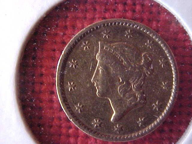 41: (104) 1853 Dollar Gold Coin