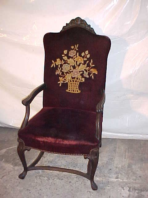3: Walnut  open arm chair w/needle point upholstery.