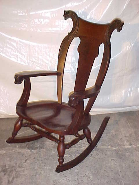 7: Victorian Lion head carved mahogany rocking chair.