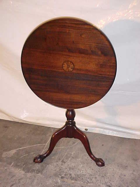 17: Restored mahogany tilt top table w/inlay design.