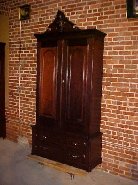 1065: Walnut Victorian double door armoire