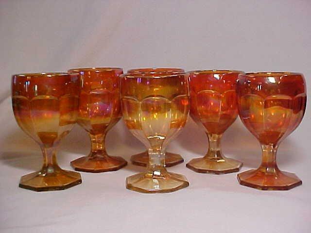 1004: Set of 6 Marigold Carnival glass stem goblets.