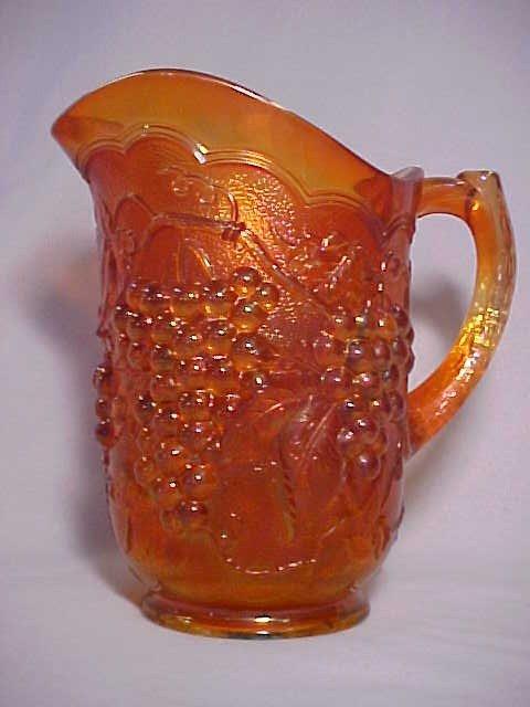 1005: Carnival glass pitcher Grape & Cable pattern mari