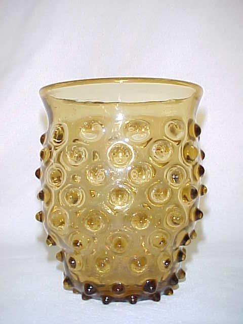 1006: Fenton Amber Hobnail vase.