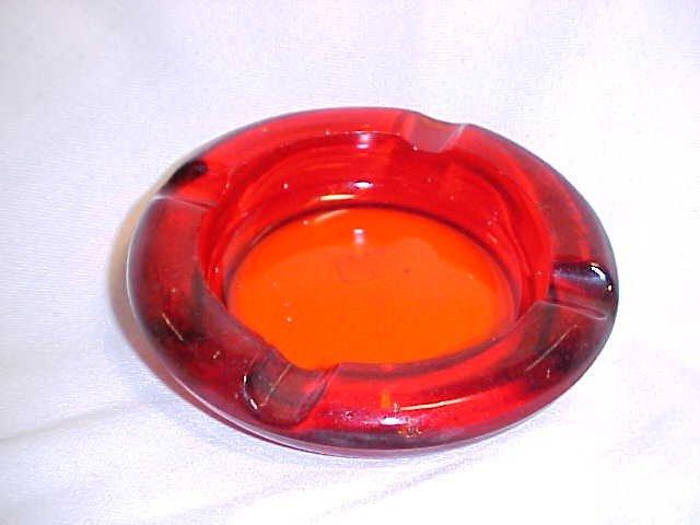 1010: Amberina glass ash tray.