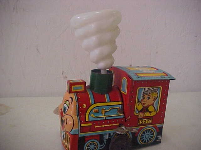 9: Tin litho wind up toy Train w/steam cloud.  Japan ma
