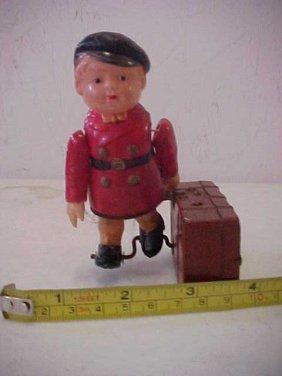 11: 1930's celluloid boy w/tin suitecase windup.