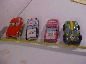 15: Lot of 4 tin litho cars.