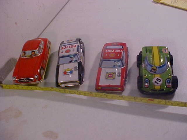 15: Lot of 4 tin litho cars.