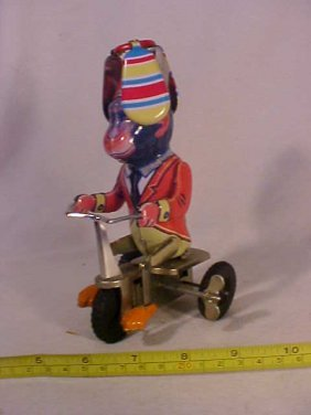 Wind Up Monkey On Tricycle W/ Spinning Cap