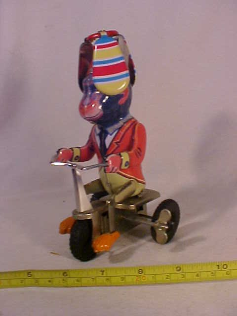 31: Wind Up Monkey on Tricycle w/ Spinning Cap