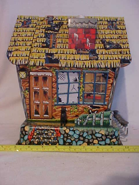45: Tin litho haunted house w/movement.