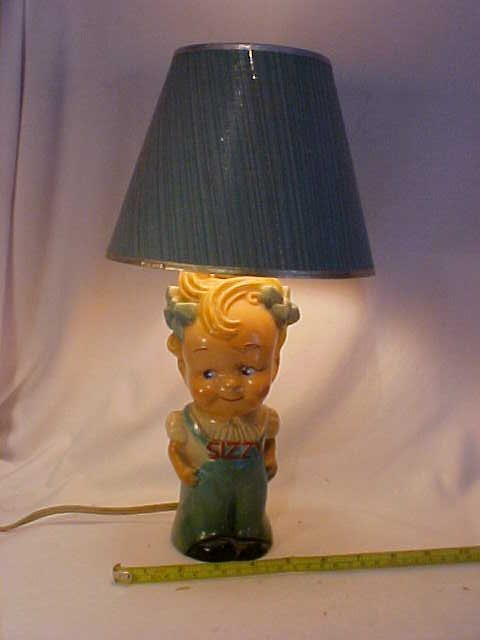 6: Early Sizzy figural lamp w/shade.