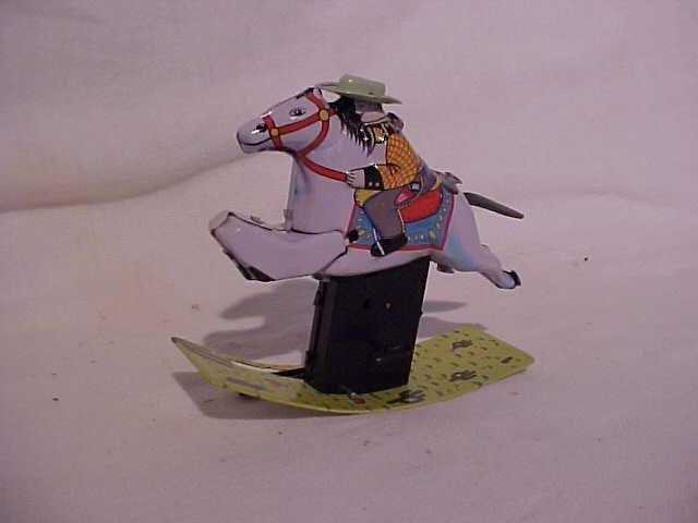 4: Tin Litho Wind-up Mechanical Rocking Cowboy