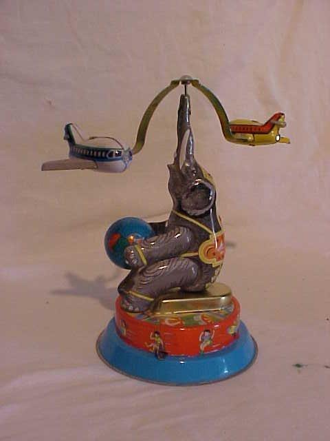 """11: Tin Litho Wind Up """"Elephant Carry Plane"""" Toy"""