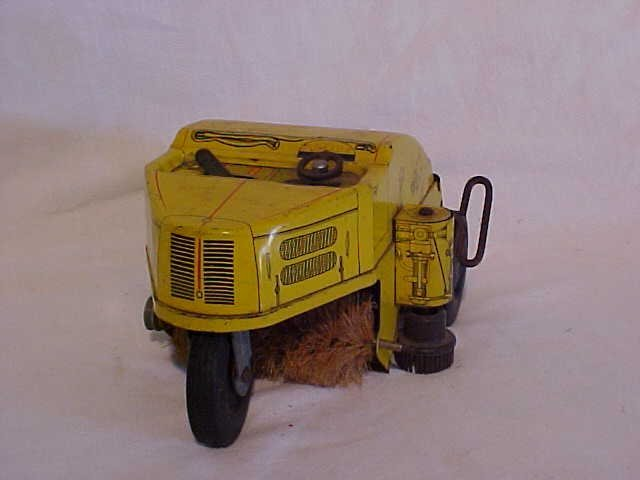 12: Tin Litho Wind Up Street Sweeper Toy