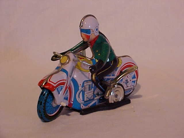 23: Tin Litho Wind Up Motorcycle Racer Toy