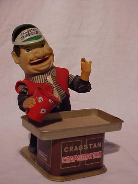 "31: Tin litho ""Cragstan Crapshooter"" toy"