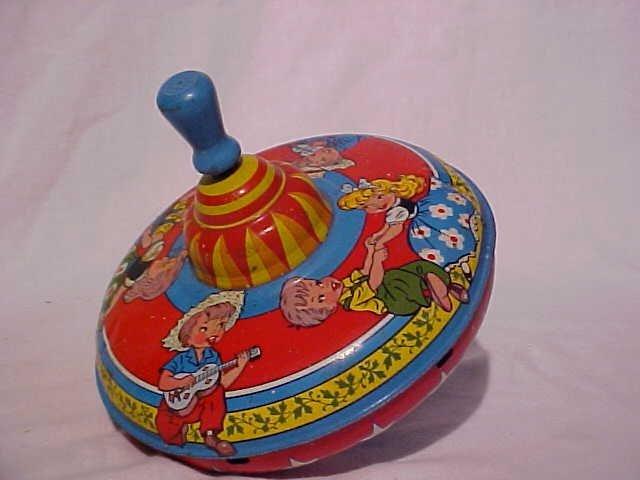37: Tin litho toy top