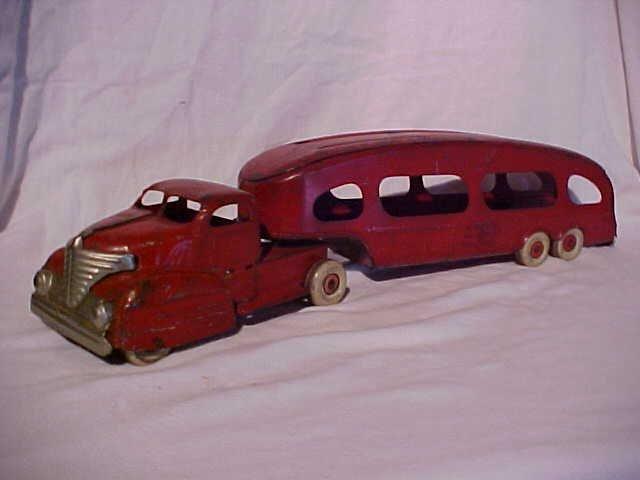 38: Marx  Press steel car hauling truck with trailer