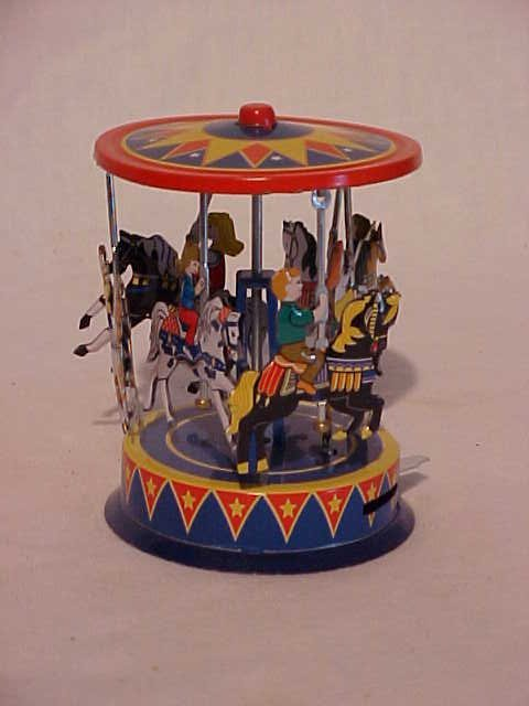 41: Tin litho pull & spin horse carousel toy