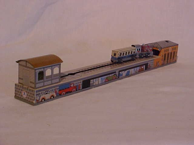 43: Tin litho wind-up train station toy