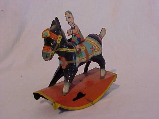47: Tin litho Clown on horse toy