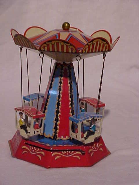 27: Tin Litho Carousel Toy