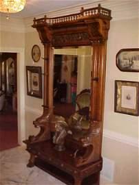 70: Large Victorian Walnut hall tree w/bench & lions.