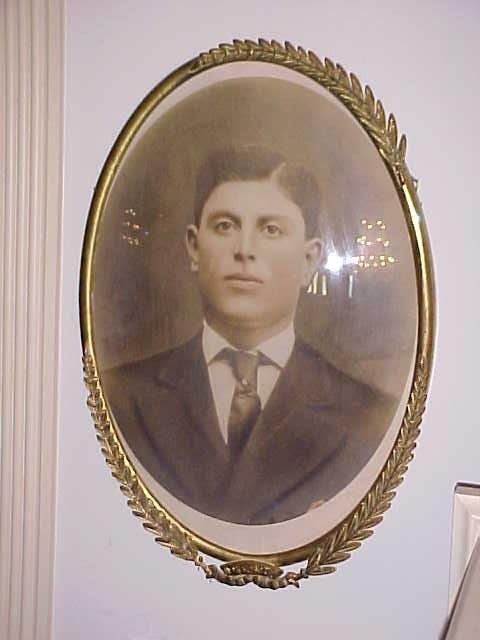 10: Early brass frame w/convex glass. Portrait of a man