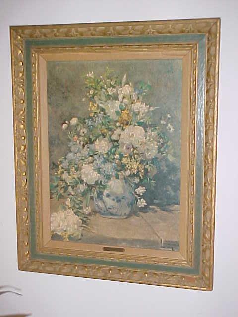 13: Floral print in wooden frame by Auguste Renoir.