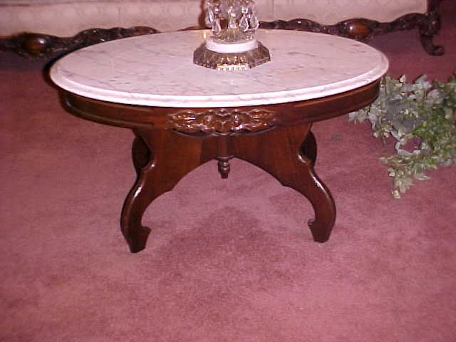 53: Victorian style lyer base marble top table.