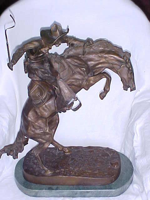 "20: Reproduction Remington bronze ""Cowboy bucking horse"