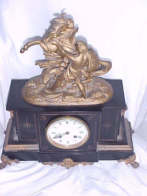 22: Antique marble clock w/porcelain face