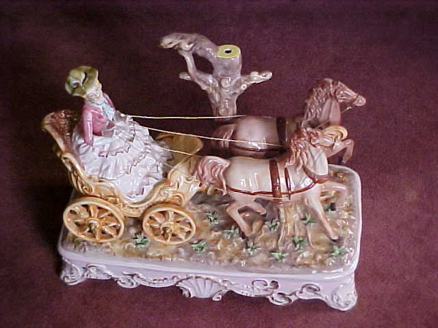 24: Porcelain lamp base Lady in carriage w/2 horses