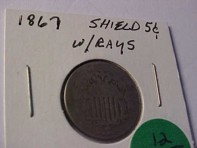 12: 1867 Shield nickel w/rays.