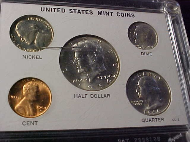 23: 1964 5 coin mint set.